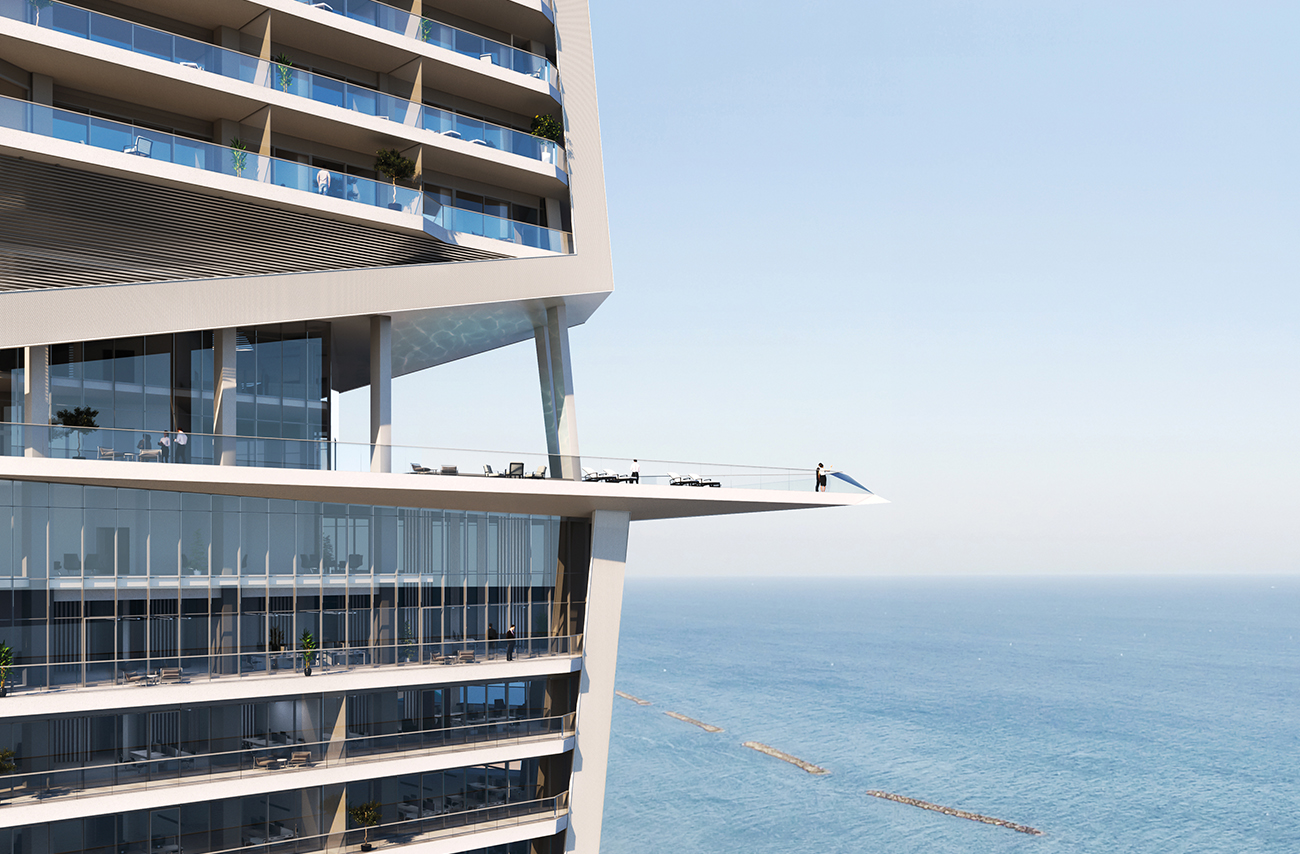 Balcony of large apartment complex overlooking blue sea