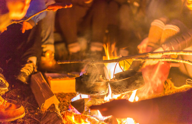 Food being cooked over an open campfire