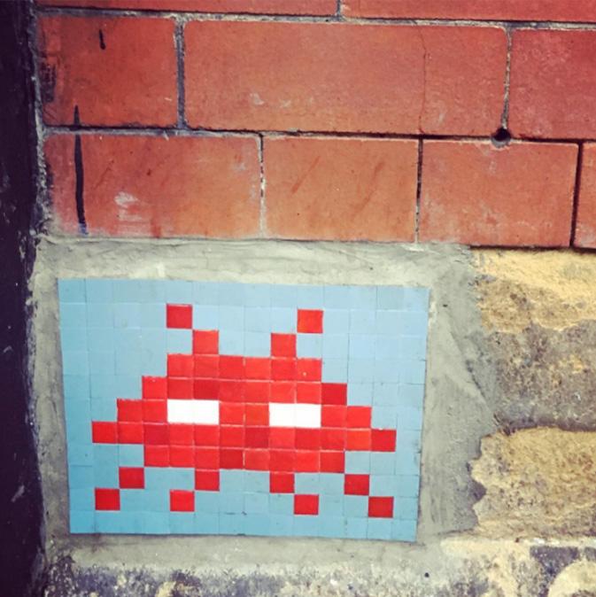 Mosaic showing computer game character on brick wall
