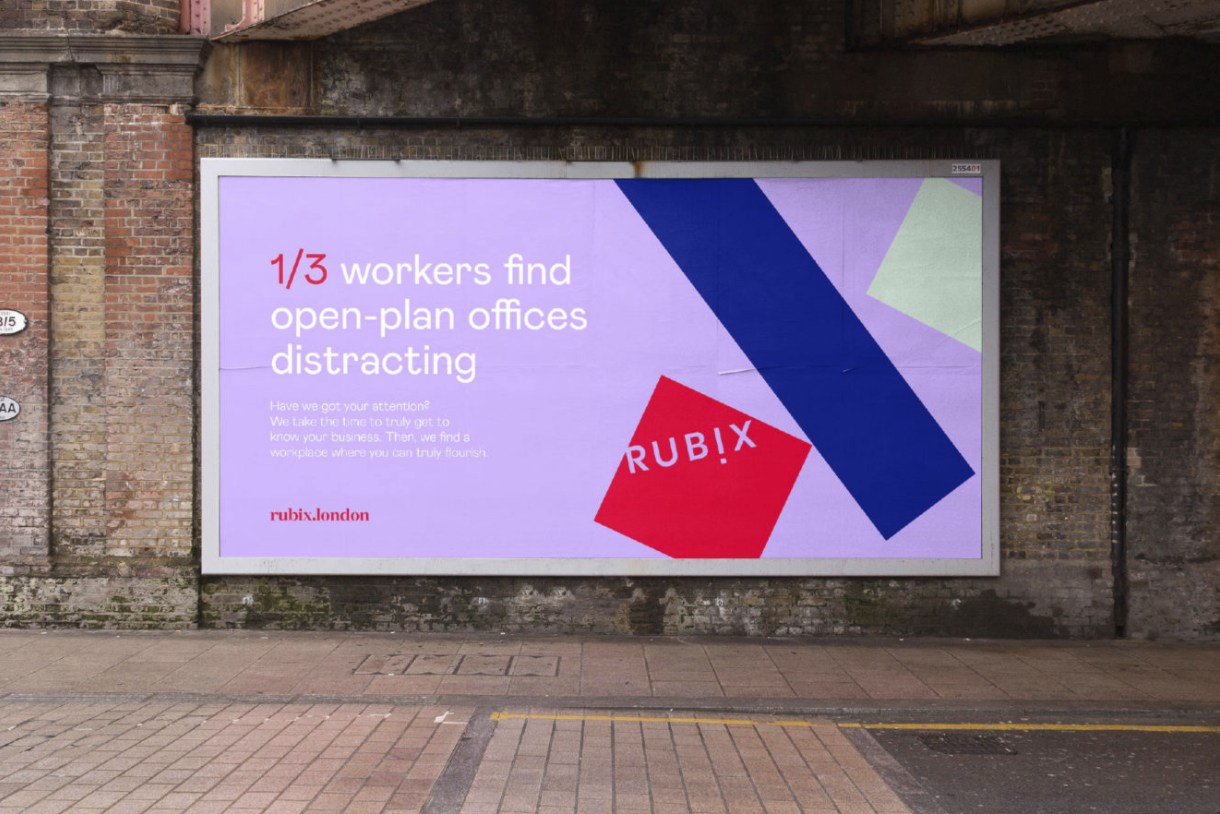 outdoor billboard with purple background and coloured blocks